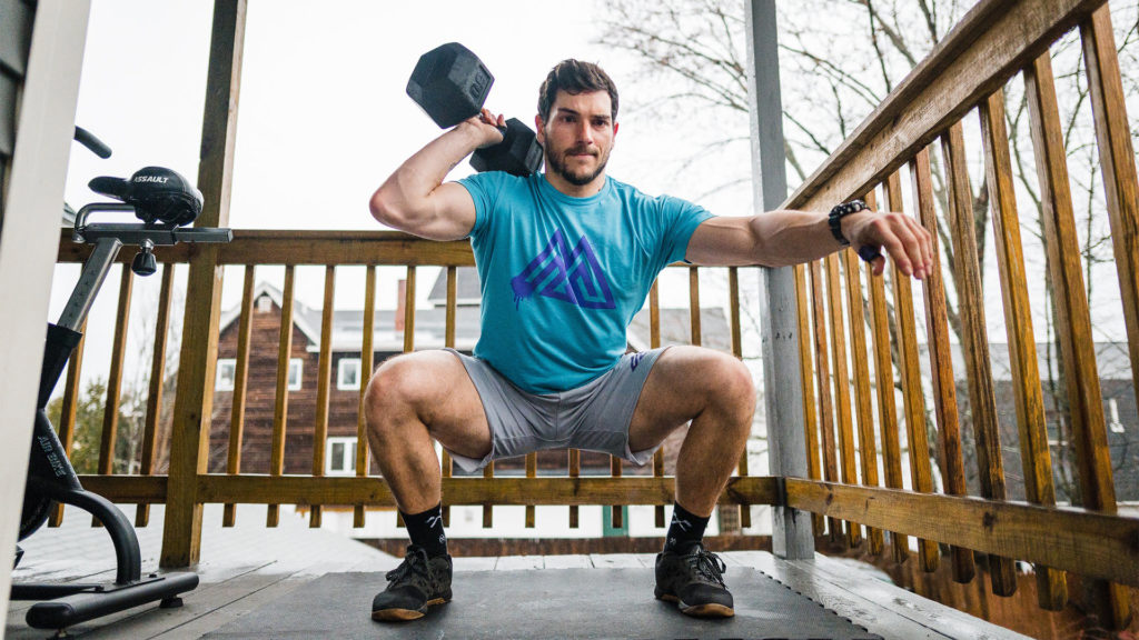 misfit anywhere at home crossfit workouts - man squatting with dumbbell